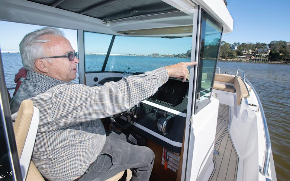 Bobby Switzer talks about Deadman's Island as his boat approaches the island off Gulf Breeze, Fla., on Feb. 24, 2021.