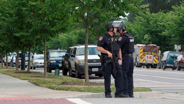 PHOTO: Virginia Beach Police Officers huddle near the intersection of Princess Anne Road and Nimmo Parkway following a shooting at the Virginia Beach Municipal Center, May 31, 2019, in Virginia Beach, Va. (Kaitlin Mckeown/The Virginian-Pilot via AP)