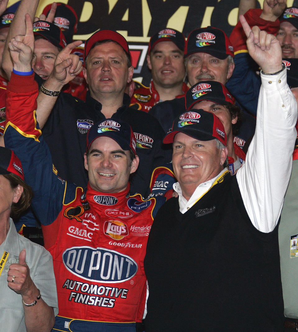FILE - NASCAR driver Jeff Gordon, left, celebrates his victory in the Daytona 500 with car owner Rick Hendrick in Victory Lane of the Daytona International Speedway in Daytona Beach, Fla., in this Sunday, Feb. 20, 2005, file photo. Jeff Gordon will leave the Fox Sports booth for a daily role at Hendrick Motorsports as vice chairman ranked second only to majority owner Rick Hendrick. The new job positions the four-time champion and Hall of Famer to eventually succeed Hendrick at the top of NASCAR's winningest organization. (AP Photo/Terry Renna, File)