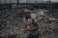 A child runs on the solidified lava flow of the Nyiragongo volcano on Friday
