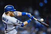 Los Angeles Dodgers' Justin Turner fouls off a pitch during the ninth inning of a baseball game against the Arizona Diamondbacks, Sunday, Sept. 26, 2021, in Phoenix. (AP Photo/Ross D. Franklin)