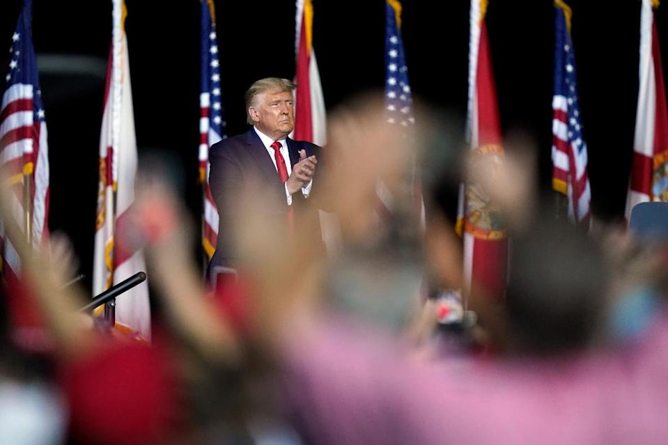 President Donald Trump applauds supporters after speaking at a campaign rally in Pensacola, Fla., Friday, Oct. 23, 2020.