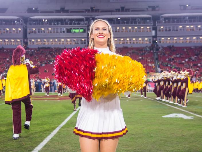 USC Song Girl Josie Bullen cheers during a Trojans football game.