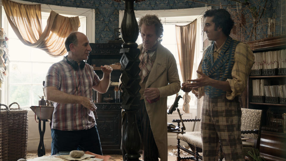 Armando Iannucci, Hugh Laurie and Dev Patel on set of 'The Personal History of David Copperfield'. (Credit: Lionsgate)