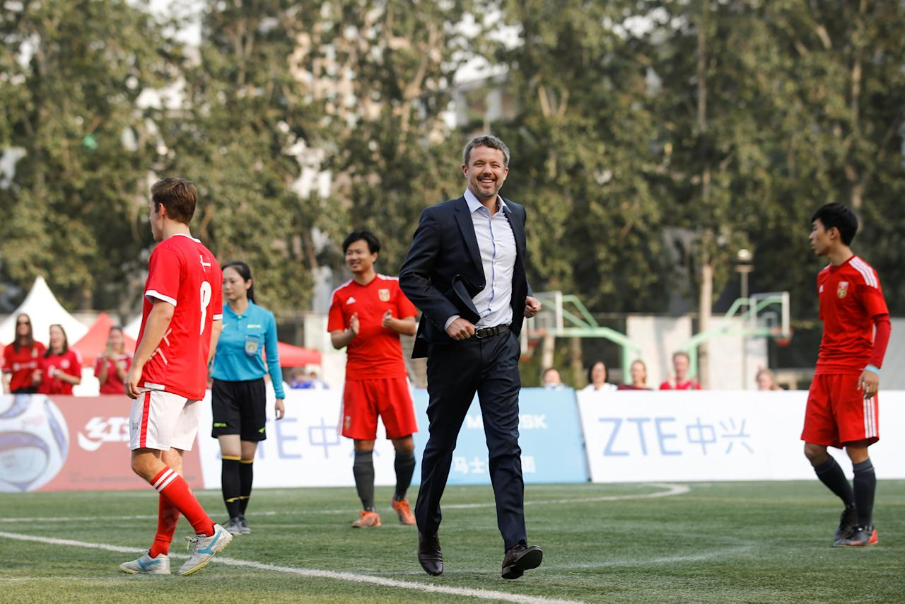 Danish Crown Prince Frederik leaves the pitch after kicking off the final of the Sino-Nordic Cup Football Tournament between Denmark and a team of the China Football Association in Beijing, China, September 23, 2017.   REUTERS/Thomas Peter