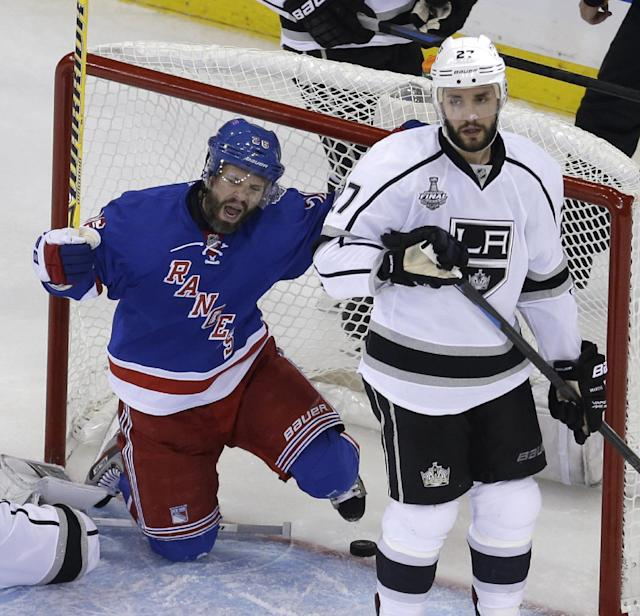 New York Rangers right wing Martin St. Louis (26), left, and Los Angeles Kings defenseman Alec Martinez (27) react after St. Louis scored in the second period during Game 4 of the NHL hockey Stanley Cup Final, Wednesday, June 11, 2014, in New York. (AP Photo/Seth Wenig)