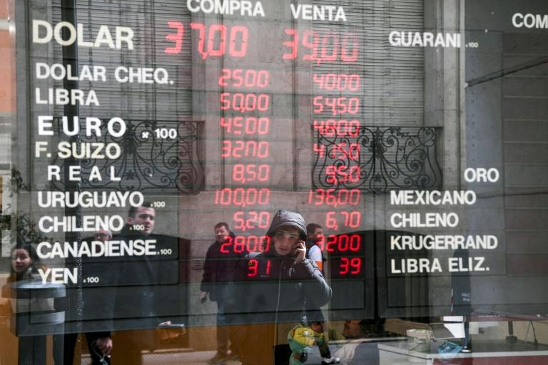 Currency exchange values are displayed on the window of a currency exhange in Buenos Aires