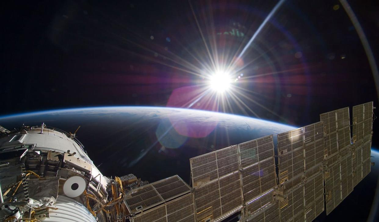 The bright sun greets the International Space Station in this Nov. 22 scene from the Russian section of the orbital outpost, photographed by one of the STS-129 crew members.