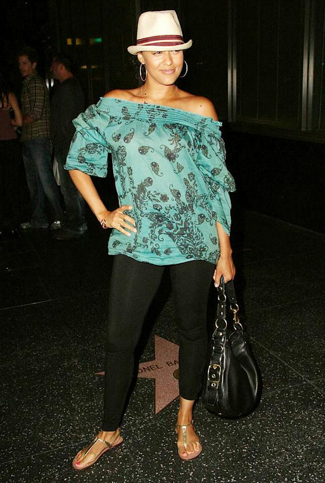 "Tia Mowry thinks she looks so fly in her fedora, patterned blouse, leggings, and metallic sandals. Well, she doesn't. Striking a pose in that ... mistake. Greg Tidwell/<a href=""http://www.pacificcoastnews.com/"" target=""new"">PacificCoastNews.com</a> - August 24, 2009"