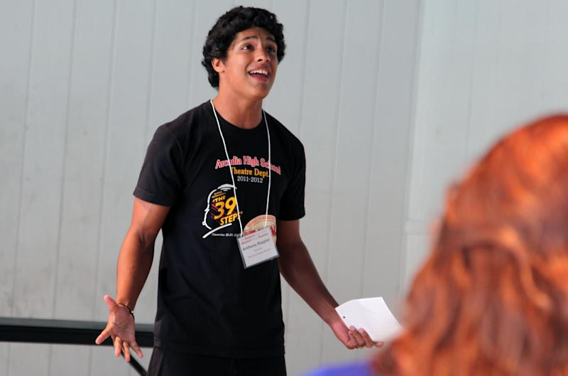 """In this Thursday, June 27, 2013, photo, Anthony Nappier of Los Angeles practices singing """"I Believe"""" from """"The Book of Mormon"""" in New York City, ahead of the National High School Musical Theater Awards on Monday, July 1. Nappier is one of 62 students from across the nation competing for the contest's top prizes and scholarship money. (AP Photo/Mark Kennedy)"""