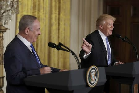 U.S. President Trump laughs with Israeli Prime Minister Netanyahu at joint news conference at the White House in Washington