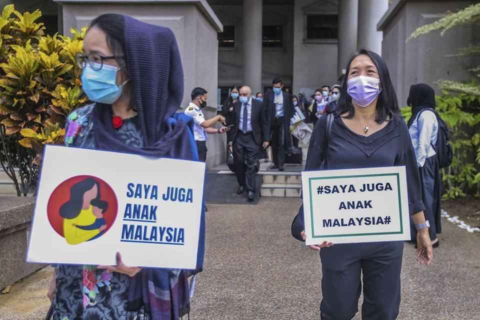 Members of Family Frontiers hold up placards demanding equal citizenship rights for Malaysians at the Kuala Lumpur High Court April 27, 2021. — Picture by Hari Anggara