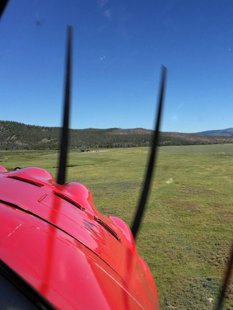 A plane lands in the grass pasture at Hell Roaring Ranch that Michael Boren uses as an airstrip. Boren has applied for a permit to designate the pasture as an official airstrip. He said that would allow it to be used by emergency services like search and rescue.