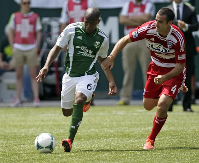 Portland Timbers forward Darlington Nagbe, left, and FC Dallas midfielder Andrew Jacobson chase down the ball during the first half of an MLS soccer game in Portland, Ore., Saturday, June 15, 2013. (AP Photo/Don Ryan)