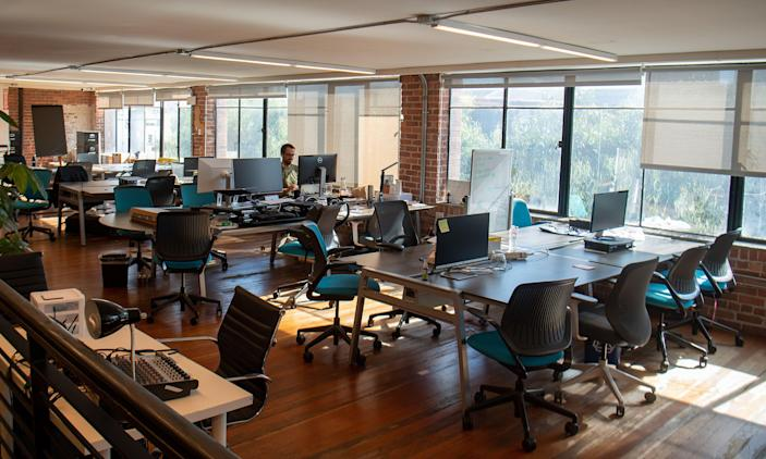 Parisoma, a coworking space, is seen mostly empty in San Francisco, California on March 12, 2020. - Tech-savvy Silicon Valley is joining the trend of remote work and classes as people seek to contain the fast-growing disease, relying on many of the technologies invented or refined in the area. (Photo by Josh Edelson / AFP) (Photo by JOSH EDELSON/AFP via Getty Images)