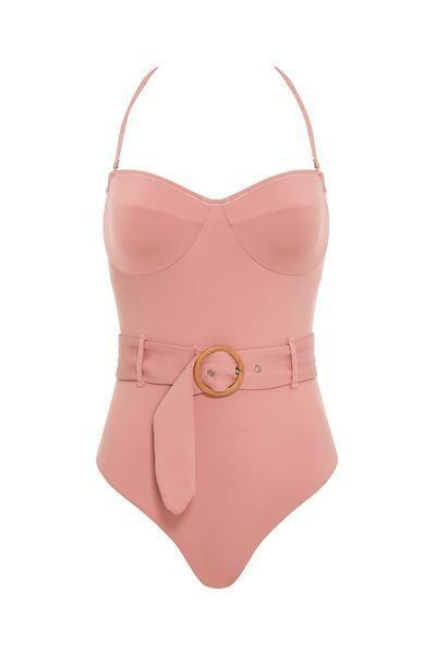 """<p><strong>Revel Rey</strong></p><p>revelrey.com</p><p><strong>$95.00</strong></p><p><a href=""""https://www.revelrey.com/collections/one-pieces/products/kate-one-piece-dusty-rose"""" rel=""""nofollow noopener"""" target=""""_blank"""" data-ylk=""""slk:Shop Now"""" class=""""link rapid-noclick-resp"""">Shop Now</a></p><p>We're seeing the circular motif pop up as part of a chic, adjustable belt. Pair this suit with your favorite sunglasses for a simple two-step look. </p>"""