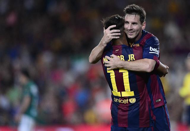 Barcelona's Neymar is congratulated by his teammate Lionel Messi during a football match at the Camp Nou stadium in Barcelona on August 18, 2014 (AFP Photo/Josep Lago)