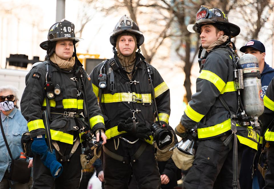 NEW YORK, NEW YORK - MARCH 30: Firefighters stand outside a store on the Upper West Side amid the coronavirus pandemic on March 30, 2021 in New York City. After undergoing various shutdown orders for the past 12 months the city is currently in phase 4 of its reopening plan, allowing for the reopening of low-risk outdoor activities, movie and television productions, indoor dining as well as the opening of movie theaters, all with capacity restrictions. (Photo by Noam Galai/Getty Images)