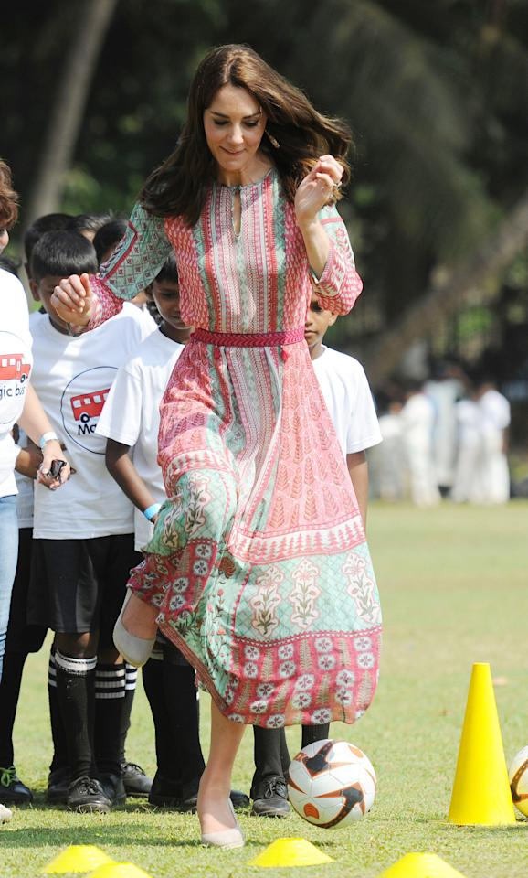 <p></p><p><span>While most prefer cleats when playing soccer, Middleton proved royals do it different: wearing wedges for a game of soccer with children from three different Mumbai charities. Proving her competitive spirit, the Duchess didn't hold back from kicking and passing the soccer ball. <em>(Photo via Getty Images)</em></span> </p><p></p>