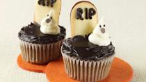 """<p>Turn your normal cupcakes into a graveyard with ghosts. This spooky treat takes a simple cupcake recipe and adds white frosting piped into ghoulish shapes while <a href=""""https://www.thedailymeal.com/cook/our-50-best-cookie-recipes-slideshow?referrer=yahoo&category=beauty_food&include_utm=1&utm_medium=referral&utm_source=yahoo&utm_campaign=feed"""" rel=""""nofollow noopener"""" target=""""_blank"""" data-ylk=""""slk:cookies"""" class=""""link rapid-noclick-resp"""">cookies</a> act as a tasty tombstone.</p> <p><a href=""""https://www.thedailymeal.com/recipe/halloween-cupcakes-ghosts-recipe?referrer=yahoo&category=beauty_food&include_utm=1&utm_medium=referral&utm_source=yahoo&utm_campaign=feed"""" rel=""""nofollow noopener"""" target=""""_blank"""" data-ylk=""""slk:For the Ghosts in the Graveyard Cupcakes recipe, click here."""" class=""""link rapid-noclick-resp"""">For the Ghosts in the Graveyard Cupcakes recipe, click here. </a></p>"""