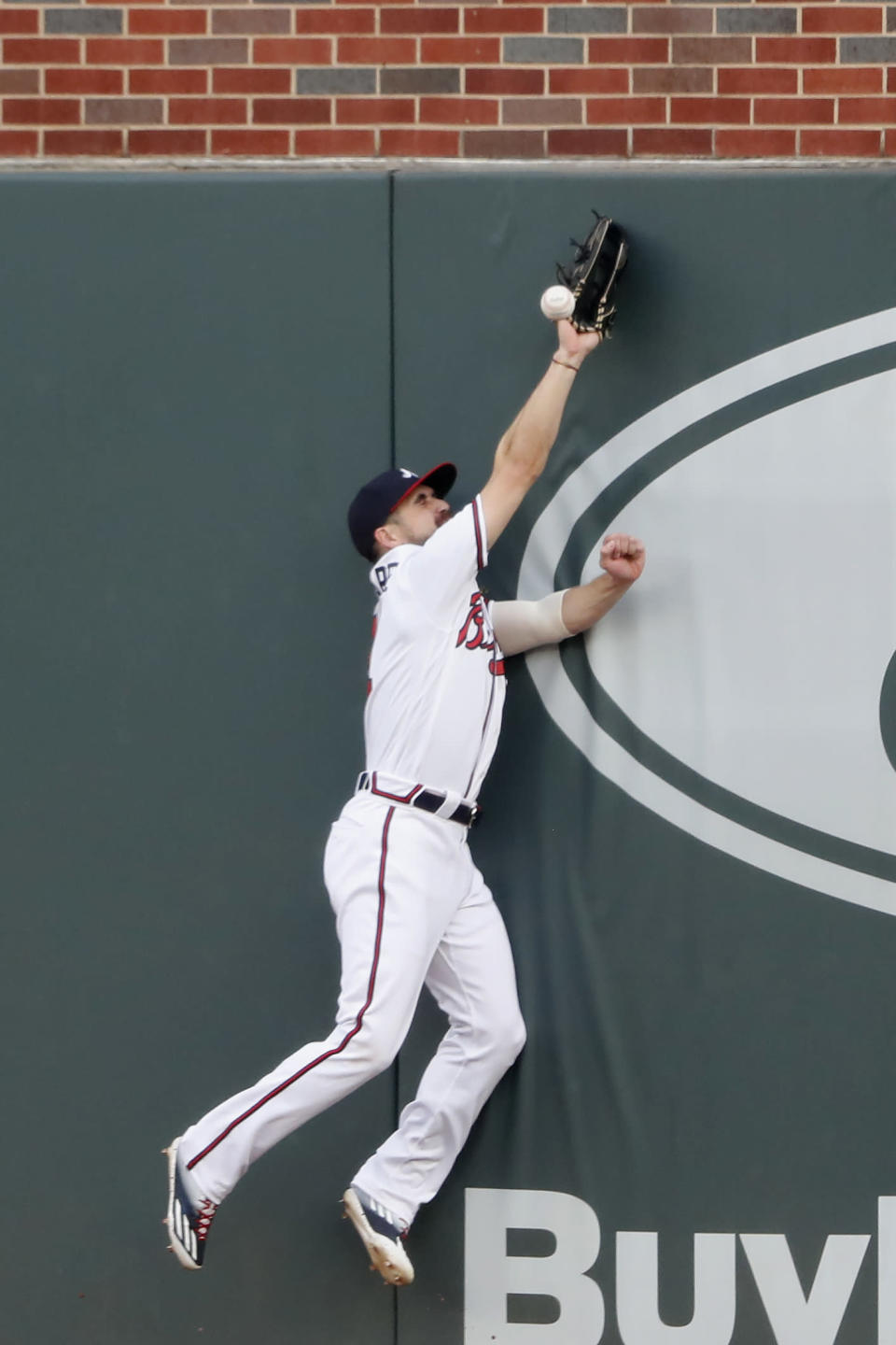 Atlanta Braves center fielder Ender Inciarte (11) can't reach a ball hit for a double by Toronto Blue Jays' Vladimir Guerrero Jr. in the second inning of a baseball game Wednesday, Aug. 5, 2020, in Atlanta. (AP Photo/John Bazemore)