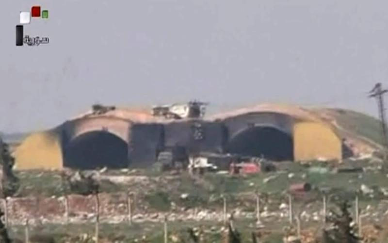 Syrian official TV showed the burned and damaged hangar that was attacked by the US Tomahawk missiles - Credit: Syrian government TV/AP