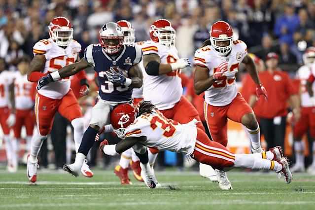 <p>Ron Parker #38 of the Kansas City Chiefs attempts to tackle Mike Gillislee #35 of the New England Patriots during the first half of their game at Gillette Stadium on September 7, 2017 in Foxboro, Massachusetts. (Photo by Maddie Meyer/Getty Images) </p>