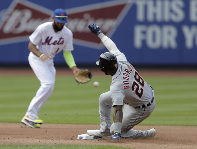 Detroit Tigers' Niko Goodrum (28) slides into second base as New York Mets shortstop Amed Rosario (1) is unable to handle a single by Tigers' Dawel Lugo during the first inning of an interleague baseball game, Saturday, May 25, 2019, in New York. Goodrum moved to third on the play. (AP Photo/Julio Cortez)