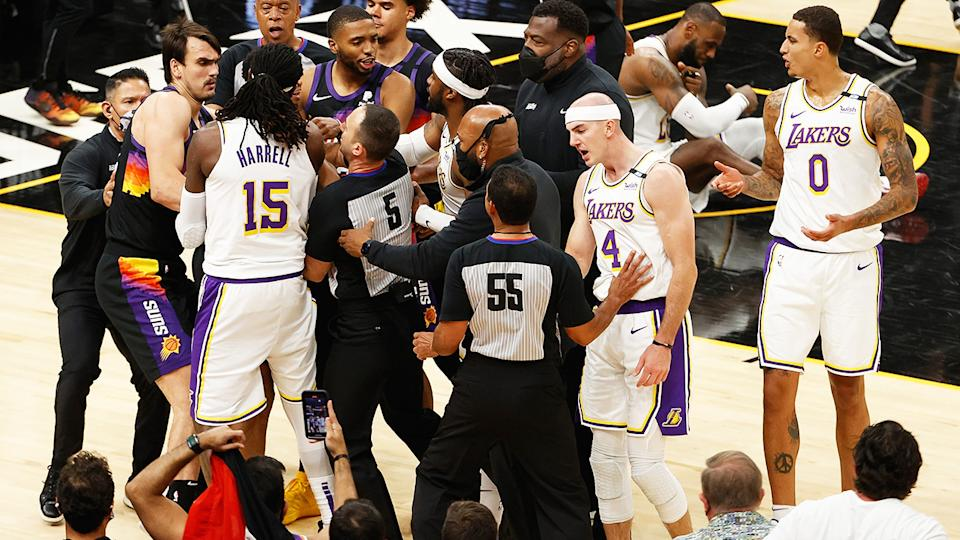 The Lakers and Suns had to be separated early in the fourth quarter of the first match in their NBA playoff series, with Suns guard Cameron Payne getting tossed from the game as a result. (Photo by Christian Petersen/Getty Images)
