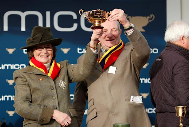 Horse Racing - Cheltenham Festival - Cheltenham Racecourse, Cheltenham, Britain - March 16, 2018 Owners Garth and Anne Broom celebrate with the trophy after Richard Johnson rode Native River to victory in the 15.30 Timico Cheltenham Gold Cup Chase Action Images via Reuters/Andrew Boyers