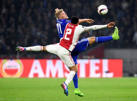 Football Soccer - Ajax Amsterdam's v Kobenhavn- UEFA Europa League Round of 16 Second Leg - Amsterdam Netherlands - 16/03/17 - Ajax Amsterdam's Kenny Tete and Kobenhavn's Andreas Cornelius in action. REUTERS/United Photos/Toussaint Kluiters