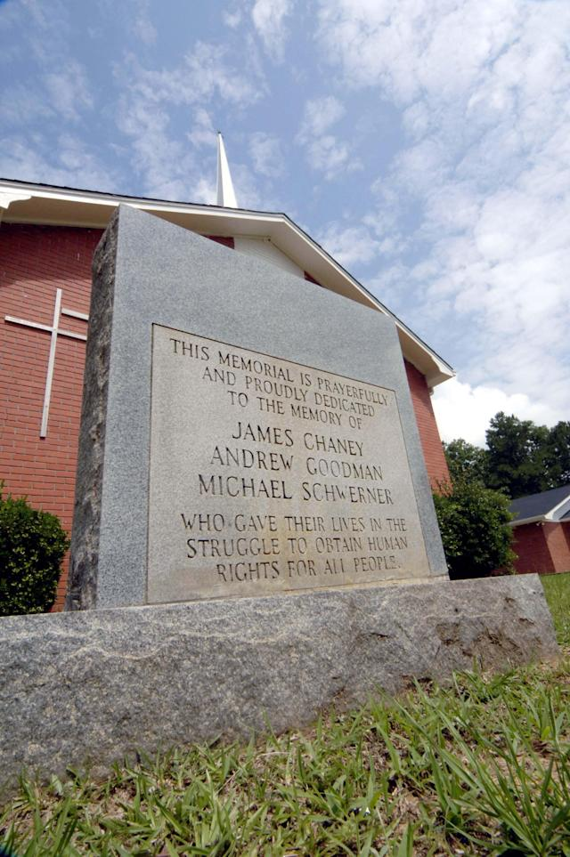 <p>A stone outside the Mt. Zion United Methodist Church memorializes three men, James Chaney, Michael Schwerner and Andrew Goodman June 10, 2005 in Philadelphia, Mississippi. The men were sent to investigate a fire at the church and beatings of church members by Klansmen. The men later disappeared and their bodies were discovered Aug. 4, 1964, in an earthen dam outside of Philadelphia. The case, which came to be known as Mississippi Burning, was said to have paved the way for the U.S. civil rights movement. (Photo: Marianne Todd/Getty Images) </p>