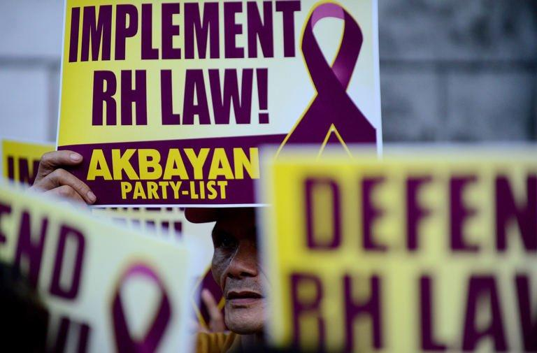 Activists supporting the Reproductive Health Law hold a protest in front of the Supreme Court in Manila, March 19, 2013