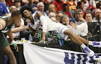 <p>Kansas guard Josh Jackson (11) crashes into the scorers' table with Michigan State guard Joshua Langford, left, in the second half of a second-round game in the men's NCAA college basketball tournament in Tulsa, Okla., Sunday, March 19, 2017. (AP Photo/Sue Ogrocki) </p>