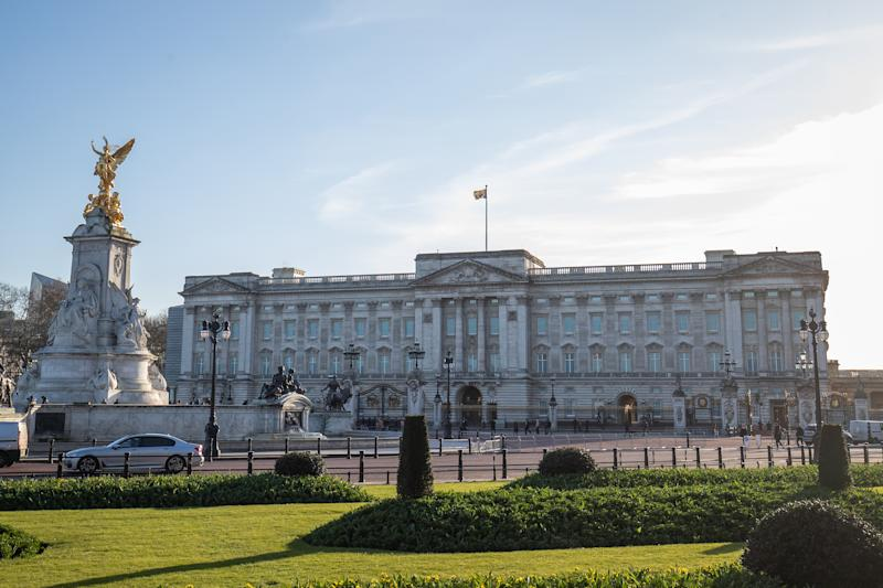 The Royal Standard flies above Buckingham Palace, London, as Queen Elizabeth II returned to central London despite the coronavirus outbreak. (Photo by Aaron Chown/PA Images via Getty Images)