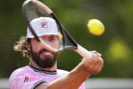 United States's Reilly Opelka plats return to Spains Jaume Lunar during their second round match on day four of the French Open tennis tournament at Roland Garros in Paris, France, Wednesday, June 2, 2021. (AP Photo/Michel Euler)