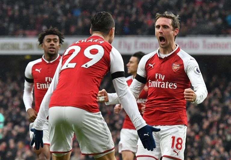 Arsenal's defender Nacho Monreal (R) celebrates after scoring with midfielder Granit Xhaka during the English Premier League football match against Crystal Palace January 20, 2018