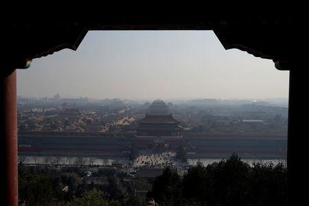 Forbidden City is seen amid smog ahead of Chinese Lunar New Year in Beijing, China February 13, 2018. Picture taken February 13, 2018. REUTERS/Jason Lee