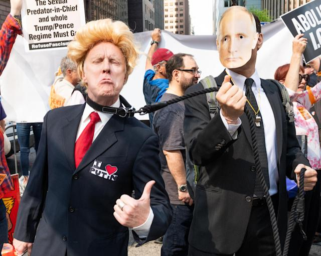 <p>A fake Donald Trump on a leash held by a fake Vladimir Putin at a protest rally against Donald Trump outside the Lotte New York Palace Hotel in New York City. Protesters took to the street to New York City in an anti Donald Trump rally against his foreign policy on July 7, 2017. (Photo: Michael Brochstein/SOPA Images/LightRocket via Getty Images) </p>