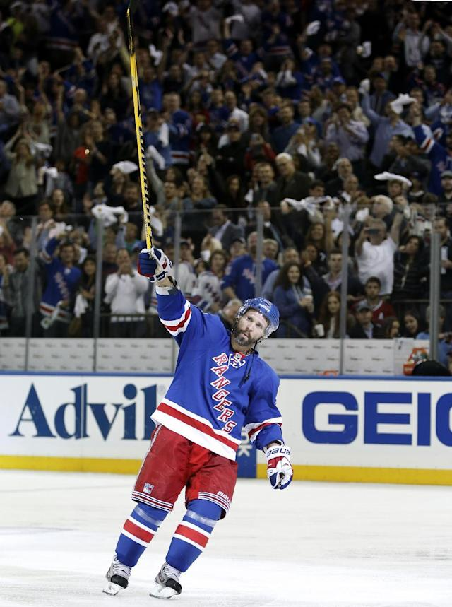 New York Rangers right wing Martin St. Louis (26) celebrates his game-winning goal in overtime of Game 4 of the NHL hockey Stanley Cup playoffs Eastern Conference finals, Sunday, May 25, 2014, in New York. The Rangers defeated the Canadiens 3-2 to go up 3-1 in the series. (AP Photo/Kathy Willens)