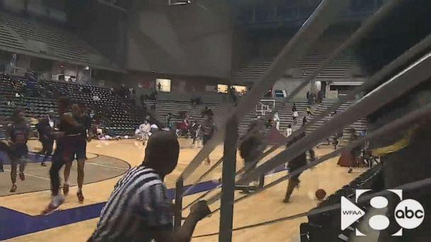 PHOTO: In this still from a video, people run after a shooting broke out at a high school basketball game in Dallas over the weekend. (WFAA)