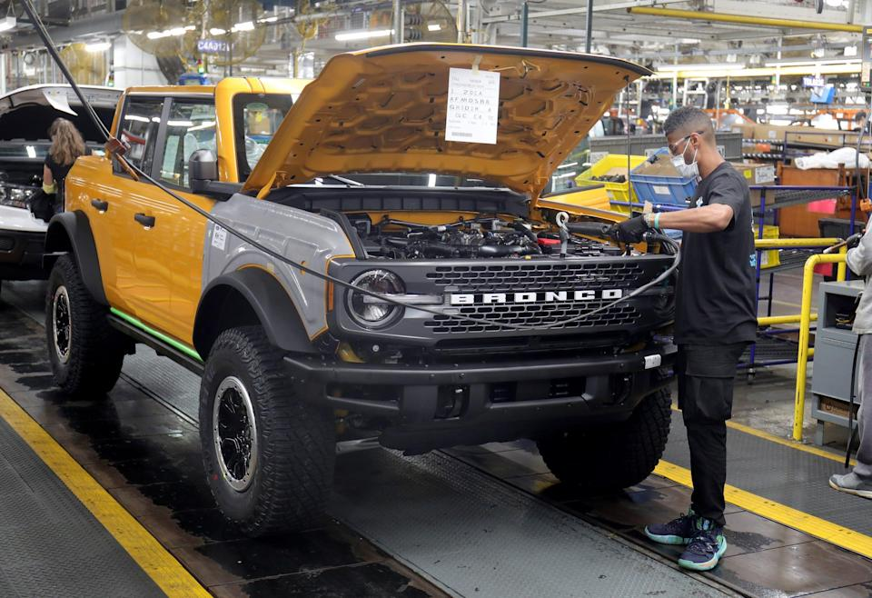 The front grille goes onto a Ford Bronco on Monday, June 14, 2021, at the Michigan Assembly Plant in Wayne.