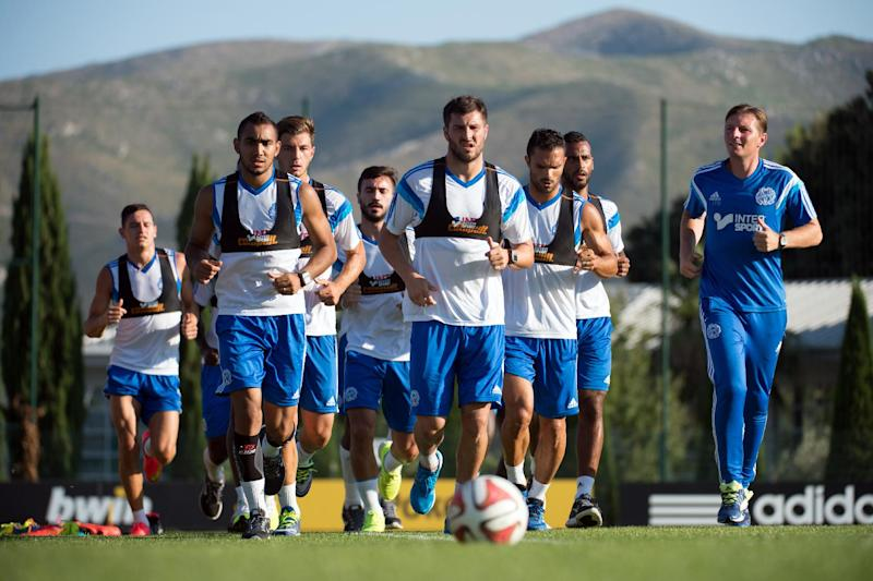 Olympique de Marseille's players run during a training session at the Robert Louis-Dreyfus training centre in Marseille, southern France, on August 12, 2014 (AFP Photo/Bertrand Langlois)