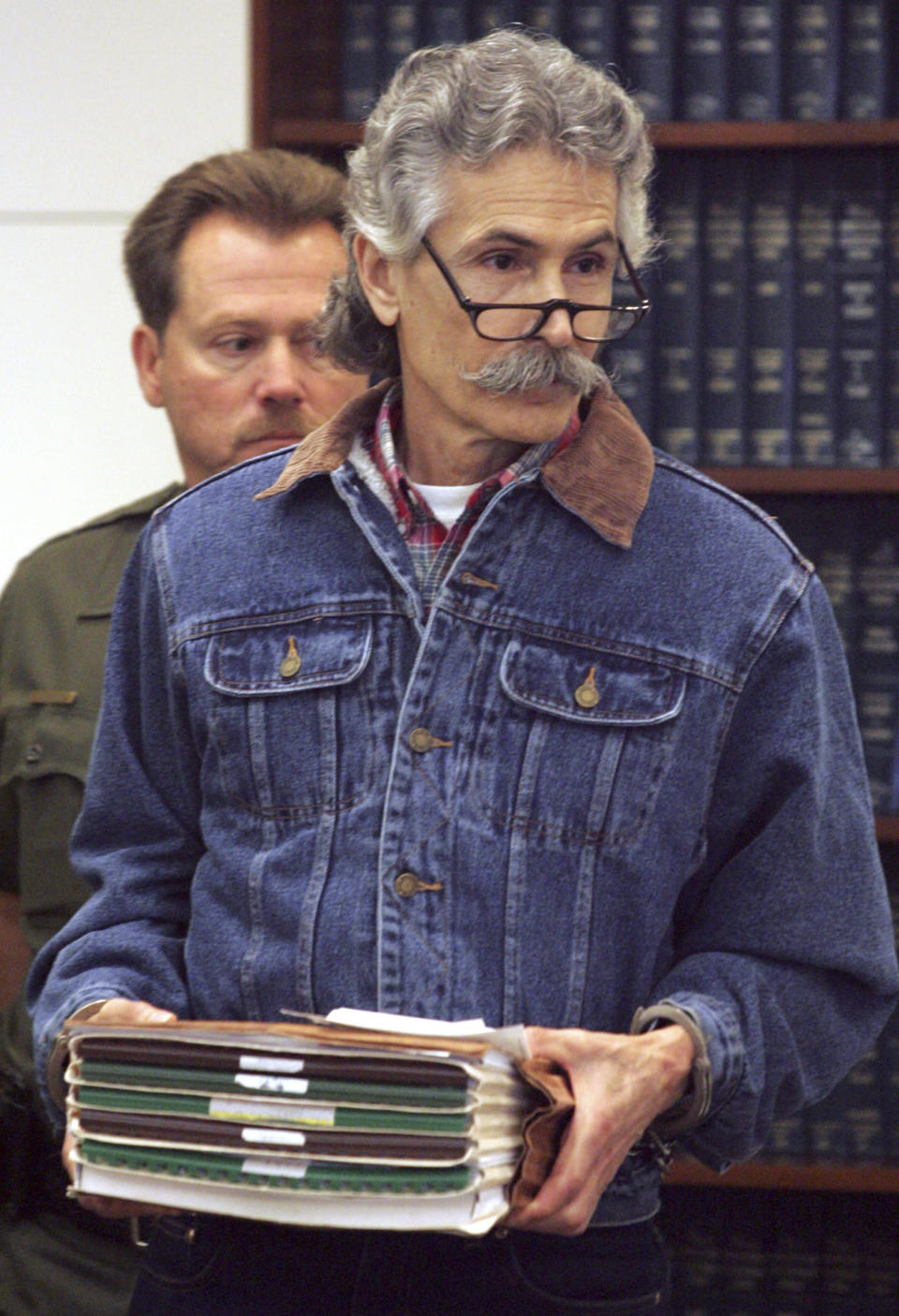 """FILE - In this Sept, 19, 2005, file photo, Rodney James Alcala, a former death row inmate who was twice convicted of the 1979 killing of a 12-year-old Huntington Beach girl, is shown in Orange County Superior Court in Santa Ana, Calif. Alcala, a prolific serial torture-slayer dubbed """"The Dating Game Killer"""" has died while awaiting execution in California. He died of natural causes at a hospital in San Joaquin Valley, Calif., prison officials said in a statement. (Ygnacio Nanetti/The Orange County Register via AP)"""