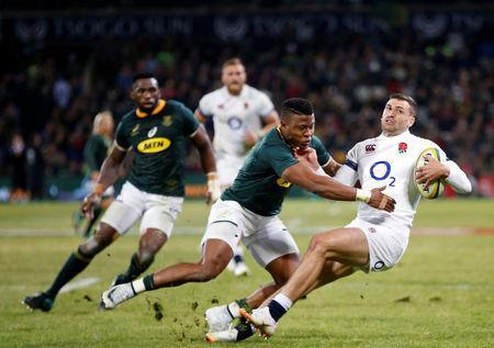 Rugby Union - Second Test International - South Africa v England - Free State Stadium, Bloemfontein, South Africa - June 16, 2018. England's Johny May and South Africa's Aphiwe Dyantyi in action. REUTERS/Siphiwe Sibeko