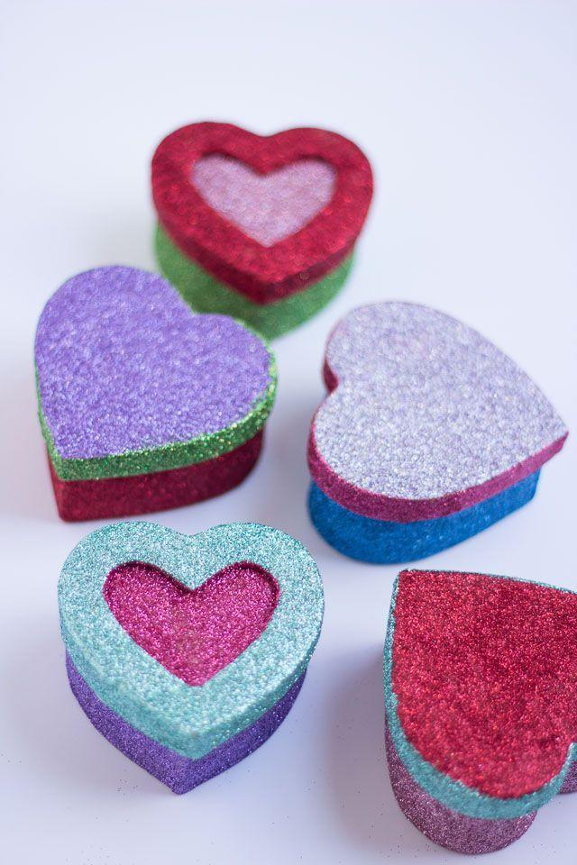 """<p>Make one (or a bunch!) of these cute glitter boxes to display or store your Valentines. Or use them as a gift box for giving a gift to your sweetheart.</p><p><strong>Get the tutorial at</strong><strong> <a href=""""https://designimprovised.com/2014/01/valentines-day-crafts-2.html"""" rel=""""nofollow noopener"""" target=""""_blank"""" data-ylk=""""slk:Design Improvised."""" class=""""link rapid-noclick-resp"""">Design Improvised. </a></strong></p><p><a class=""""link rapid-noclick-resp"""" href=""""https://www.amazon.com/Darice-2849-05-Paper-Mache-Heart/dp/B00NMOH64E/?tag=syn-yahoo-20&ascsubtag=%5Bartid%7C2164.g.35119968%5Bsrc%7Cyahoo-us"""" rel=""""nofollow noopener"""" target=""""_blank"""" data-ylk=""""slk:SHOP PAPER MACHE HEARTS"""">SHOP PAPER MACHE HEARTS</a></p>"""