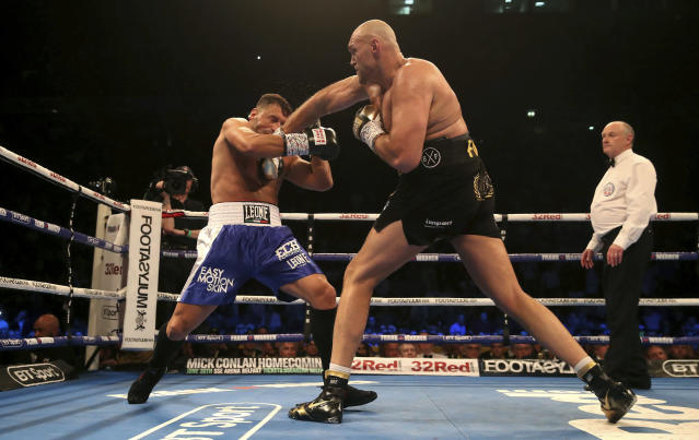 Britain's Tyson Fury, right, lands a punch to Sefer Seferi during their heavyweight bout at the Manchester Arena, in Manchester, England, Saturday June 9, 2018. (Nick Potts/ PA via AP)