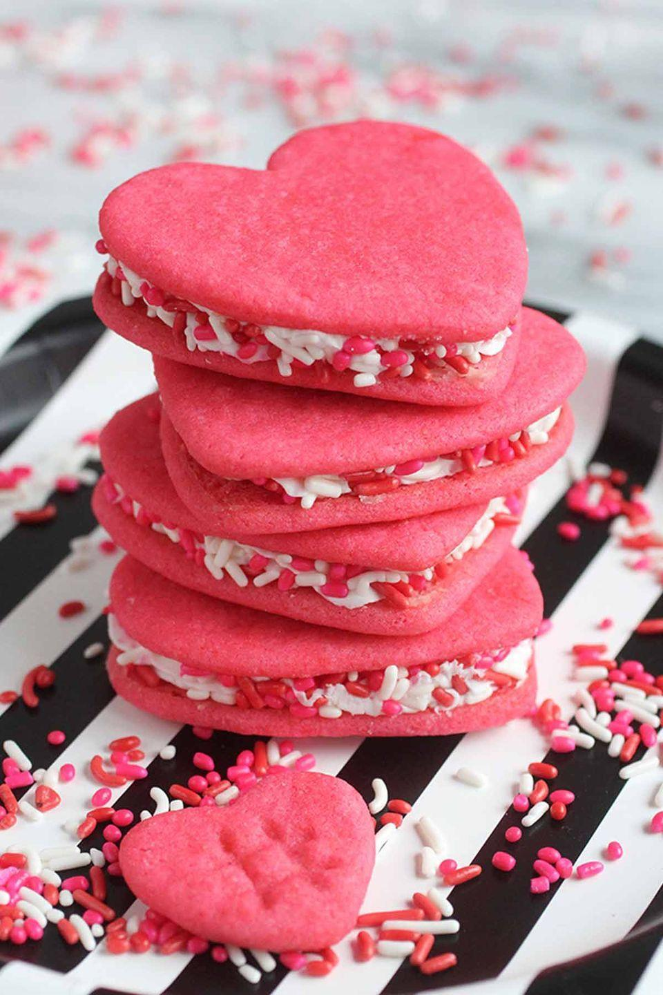 "<p><span class=""redactor-invisible-space"">Sugar, oh honey, now this is the ultimate Valentine's Day cookie sandwich! </span></p><p><strong>Get the recipe at <a href=""https://ispydiy.com/diy-eats-conversation-heart-cookie-sandwich/"" rel=""nofollow noopener"" target=""_blank"" data-ylk=""slk:I Spy DIY"" class=""link rapid-noclick-resp"">I Spy DIY</a>.</strong></p>"