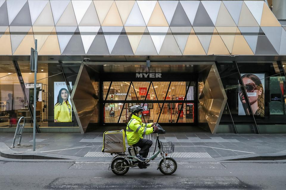 A food delivery rider makes her way in the Melbourne Central Business District on July 16, 2021, after Australia's second largest city entered a fresh lockdown amid a resurgence in coronavirus cases. (Photo by ASANKA BRENDON RATNAYAKE / AFP) (Photo by ASANKA BRENDON RATNAYAKE/AFP via Getty Images)