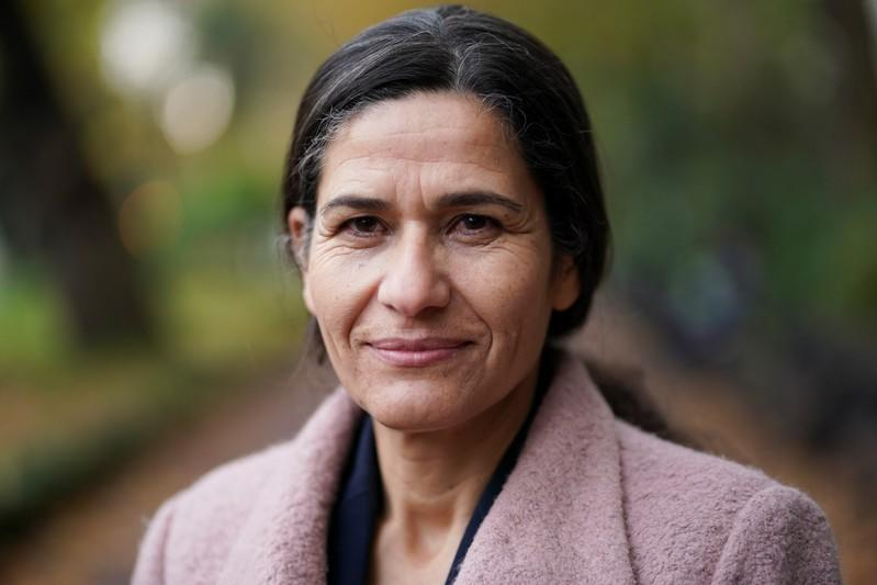 The President of the Executive Committee of the Syrian Democratic Council Ilham Ahmed poses for a portrait in central London